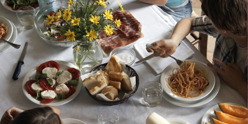 family having typical italian meal
